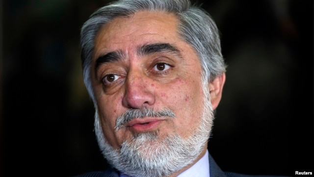 Former Afghan foreign minister Abdullah Abdullah speaks during an interview in Kabul April 13, 2014.