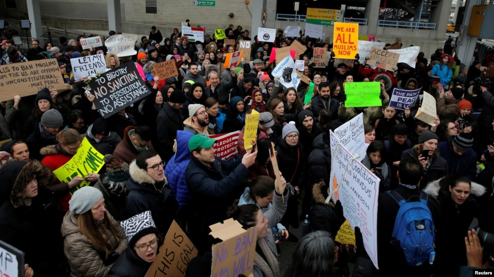 A crowd gathers to protest President Donald Trump's travel ban at John F. Kennedy International Airport in Queens, New York, Jan. 28, 2017. (REUTERS/Andrew Kelly)