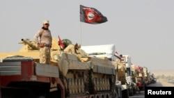 资料照: 伊拉克政府军车队向摩苏尔前进,2016年10月12日。