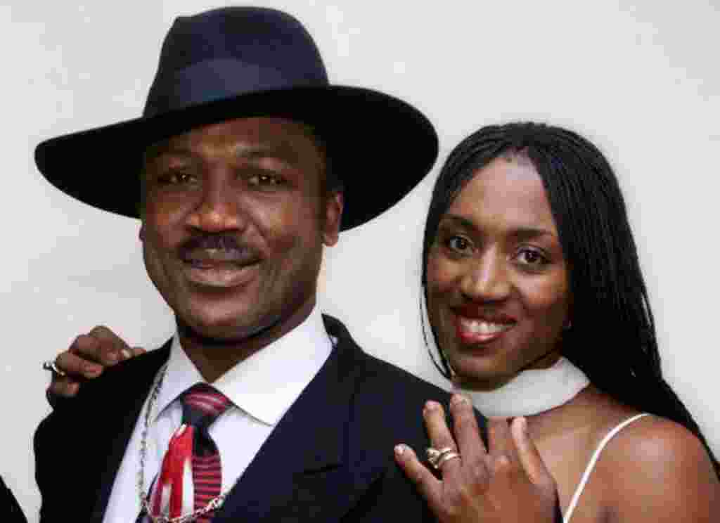 "Former heavyweight champion Joe Frazier poses with his daughter Jacqueline, also a boxer, at a screening of ""Ali-Frazier 1: One Nation...Divisible"" in New York Wednesday, Aug. 2, 2000 in New York. The documentary of the famous 1971 bout between Joe Fraz"