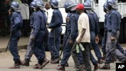 FILE - Zimbabwean police arrest an MDC supporter in Harare.