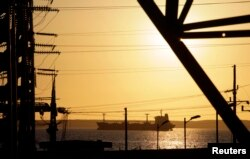 A fuel tanker travels near the Cienfuegos Oil Refinery some 240 kilometres, (150 miles), southeast of Havana, Feb. 7, 2013.