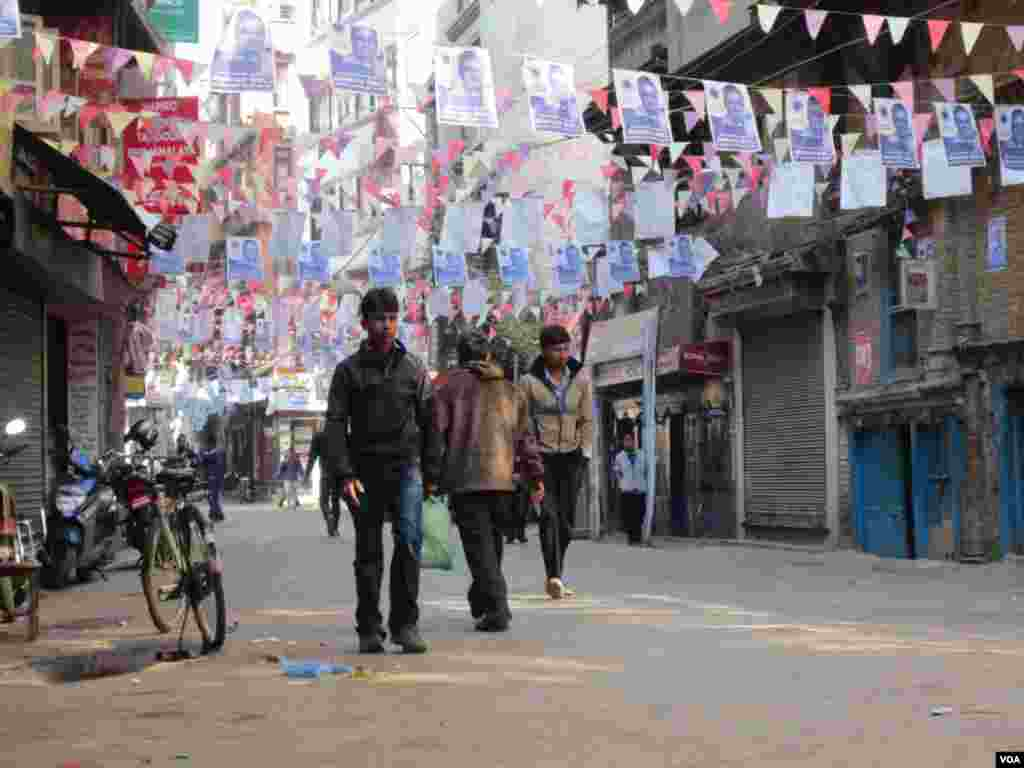 Campaign signs line an alley in Nepal's capital, Kathmandu, Nov. 17, 2013. (Aru Pande/VOA)