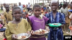 Children receiving food from the United Nations World Food Program.