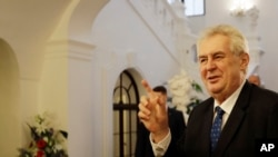 FILE - Czech Republic's President Milos Zeman arrives for a parliamentary session in Prague, Czech Republic.