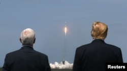 Donald Trump and U.S. Vice President Mike Pence watch the launch of a SpaceX.