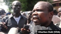 South Sudan's National Liberation Council has voted to reinstate Pagan Amum. The ruling party's ex-secretary general is shown (above) outside a court where he appeared earlier on treason charges.
