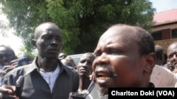 Pagan Amum, shown here in April 2014 after a South Sudanese judge released him and three others from house arrest, accuses officials in President Salva Kiir's government of threatening him and of stealing the country's resources.