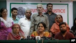 FILE - Teesta Setalvad, center, appears at a 2010 press conference in Ahmadabad, India. India has restricted activities by the US-based Ford Foundation because of its suport of an NGO founded by Setalvad.
