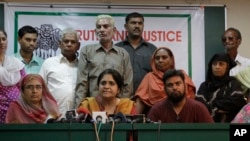 FILE - Teesta Setalvad, center, appears at a press conference in Ahmadabad, India. India has restricted activities by the US-based Ford Foundation because of its suport of an NGO founded by Setalvad.