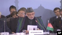 সন্ত্রাসী আক্রমণের বিরুদ্ধে আফগানিস্তান সহযোগিতা চায়: কারজাই