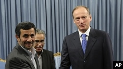 Iranian President Mahmoud Ahmadinejad, left, welcomes Russia's Security Council Secretary Nikolai Patrushev for their meeting at the presidency office, in Tehran, Iran, August 16, 2011