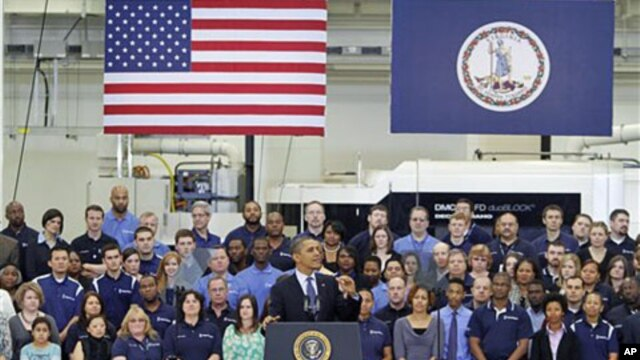 President Barack Obama gestures during a speech on the economy at the Rolls-Royce engine manufacturing plant in Prince George, Virginia, March 9, 2012.