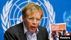FILE - World Health Organization Assistant Director General Bruce Aylward holds a report during a news conference on Ebola at the United Nations in Geneva, Sept. 16, 2014.