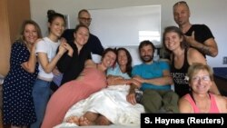 Amanda Eller, a yoga instructor who went missing for 17 days while hiking in Maui's Makawao Forest Reserve, poses for a photo at Maui Memorial Medical Center in Hawaii, after she was rescued during a search operation, May 25, 2019.