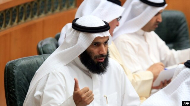 Kuwaiti Minister of Justice, Awqaf (Islamic endowments) and Islamic Affairs, Nayef al-Ajmi talks as he takes part in a parliament session at Kuwait's National Assembly, Apr. 1, 2014 in Kuwait City.