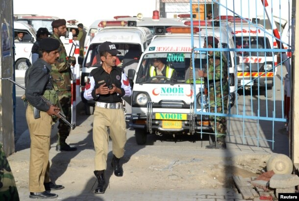 Ambulances arrive to take the dead from the hospital to be buried after they were killed in an attack on the Police Training Center in Quetta, Pakistan, Oct. 25, 2016.