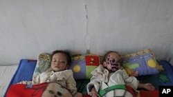 North Korean children suffering from malnutrition rest in a hospital in Haeju, capital of the area damaged by summer floods and typhoons in South Hwanghae province, October 1, 2011. I