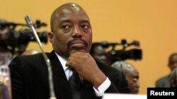 Le président Joseph Kabila ide la République Démocratique du Congo lors d'un sommet en Kampala, Ouganda