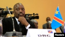 FILE - DRC President Joseph Kabila is seen at a summit in Uganda's capital, Kampala. He is limited by the constitution to seek a thrid presidential term.