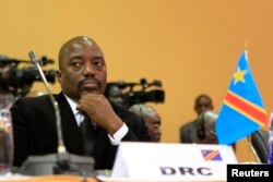 FILE - DRC President Joseph Kabila is seen at a summit in Uganda's capital, Kampala.