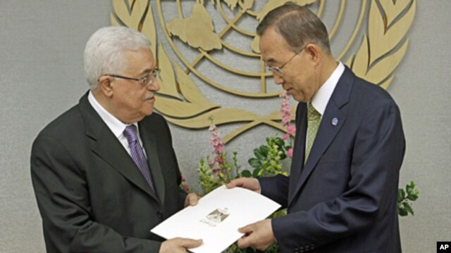 Palestinian President Mahmoud Abbas, left, gives a letter requesting recognition of Palestine as a state to Secretary-General Ban Ki-moon during the 66th session of the General Assembly at United Nations headquarters, September 23, 2011.