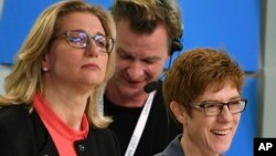 Christian Democratic top candidate Saarland governor Annegret Kramp-Karrenbauer, right, and the top candidate of the Social Democratic party Anke Rehlinger attend a TV debate after the state election in German state of Saarland in Saarbruecken, March 26,