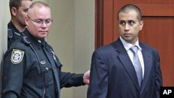 George Zimmerman, right, enters the courtroom, April 20, 2012, during a bond hearing in Sanford, Florida.