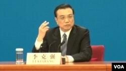 李克强总理3月13日在中外记者招待会上(美国之音 东方拍摄)