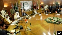 Arab League secretary-general Nabil Elaraby, fourth left, chairs an Arab League committee emergency meeting on Syria at the league's headquarters in Cairo, Egypt, Thursday, May 23, 2013, ahead of an international peace conference to end the country's civi