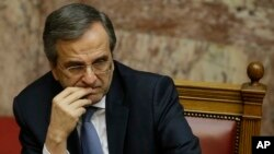 Prime Minister Antonis Samaras attends the third round of voting to elect a new Greek president at the Parliament in Athens, Dec. 29, 2014,