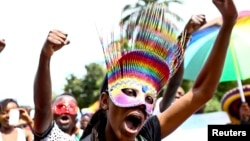 People walk in a parade as they celebrate the annulment of an anti-homosexuality law by Uganda's constitutional court in Entebbe, August 9, 2014.