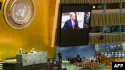 This UN handout photo shows US President Donald Trump(on screen), as he addresses the general debate of the seventy-fifth session of the United Nations General Assembly, on September 22, 2020 at the UN in New York.