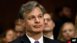FBI Director nominee Christopher Wray prepares to testify on Capitol Hill in Washington, Wednesday, July 12, 2017, at his confirmation hearing before the Senate Judiciary Committee.