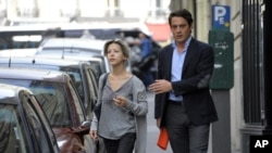 French writer Tristane Banon (L) walks with her lawyer David Koubbi as they leave his office in Paris July 5, 2011.