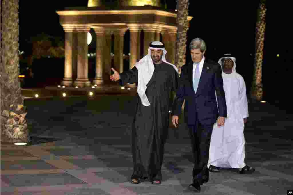 Sheikh Mohamed bin Zayed Al Nahyan invites U.S. Secretary of State John Kerry to pose with him for a photograph before their dinner meeting at the Emirates Palace hotel in Abu Dhabi, United Arab Emirates, March 4, 2013.