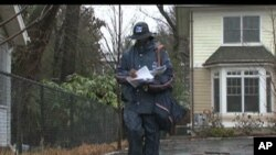Postal service employee delivering mail in Washington, DC