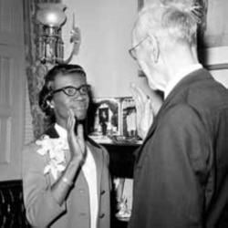 Shirley Chisholm re-enacts her swearing in ceremony with Speaker John McCormack