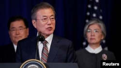 FILE - South Korean President Moon Jae-in speaks during a signing ceremony for the U.S.-Korea Free Trade Agreement on the sidelines of the 73rd United Nations General Assembly in New York, Sept. 24, 2018.