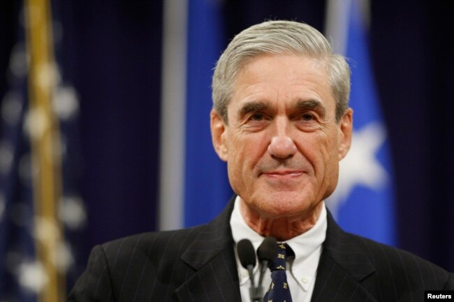 FILE - Outgoing FBI Director Robert Mueller pauses during his remarks at a farewell ceremony held for him at the Justice Department in Washington,Aug. 1, 2012.