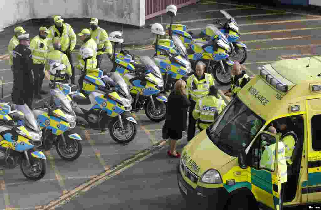 An ambulance crew and their police escort await the arrival of an air ambulance carrying 14-year-old injured Pakistani girl, Malala Yousufzai, at Birmingham International airport in central England October 15, 2012.