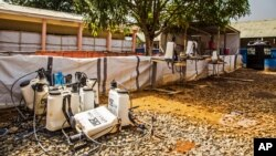 FILE - An Ebola decontamination zone at the Hastings treatment clinic has emptied as the virus shows signs of diminishing in Freetown, Sierra Leone, Jan. 23, 2015