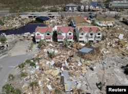 An aerial photo shows damaged and destroyed homes after Hurricane Michael smashed into Florida's northwest coast in Mexico Beach, Oct. 12, 2018.