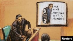 """FILE - Case agent Ryan Chabot testifies as a CD cover of the 1994 debut album of late singer Aaliyah's """"Age Ain't Nothing but a Number"""", produced by R. Kelly, is shown on a screen during R. Kelly's sex abuse trial at Brooklyn's Federal District Court in a courtroom sketch in New York, U.S., September 14, 2021."""