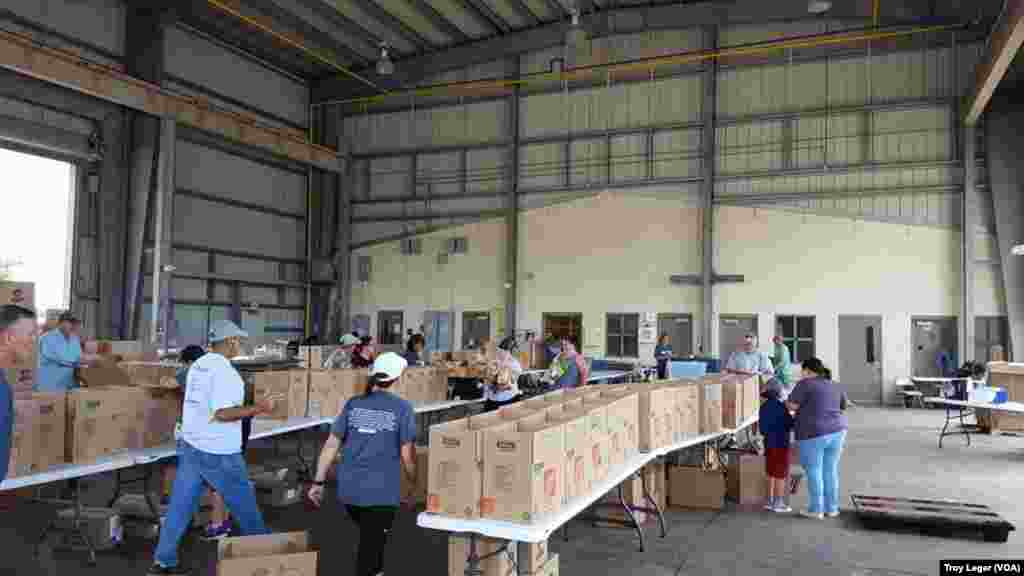 Volunteers prepare aid packages for flood victims in Lafayette, La.