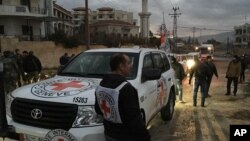 FILE - The International Committee of the Red Cross, working alongside the Syrian Arab Red Crescent (SARC) and the United Nations, shows a convoy containing food, medical items, blankets and other materials being delivered to the town of Madaya in Syria, Jan. 11, 2016