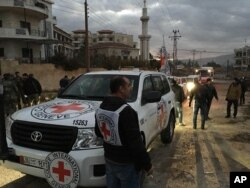 FILE - This picture provided by The International Committee of the Red Cross, working alongside the Syrian Arab Red Crescent (SARC) and the United Nations, shows a convoy containing food, medical items, blankets and other materials being delivered to the town of Madaya.