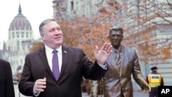 US Secretary of State, Mike Pompeo, is pictured next to a sculpture of former US President Ronald Reagan at the Liberty square, Hungary. (File)