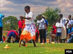 Disabled children often refrain from socializing because of their disabilities, further stigmatizing them, Kampala, Uganda, Nov. 13, 2014. (Elizabeth Paulat/VOA)