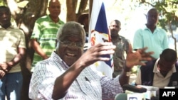 FILE - Afonso Dhlakama, the leader of the Mozambican National Resistance, gives a press conference in Gorongosa's mountains, Mozambique, April 10, 2013.